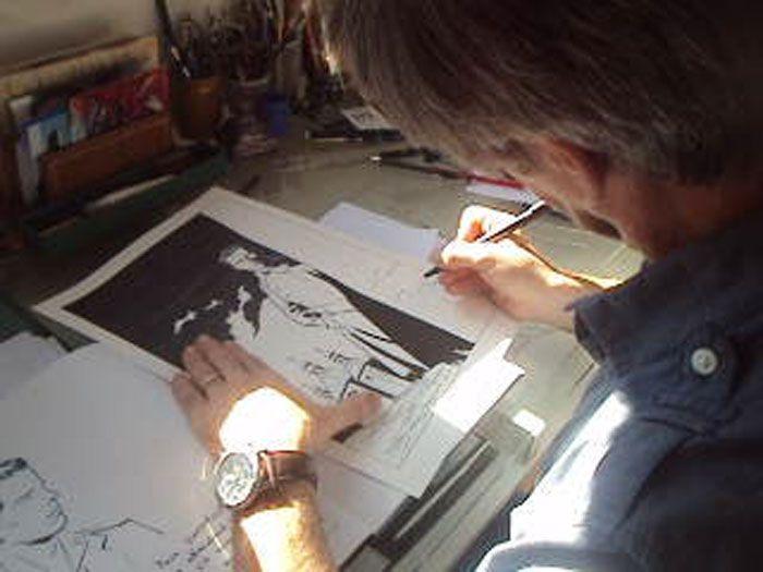 Régis Parenteau-Denoël à sa planche à dessin